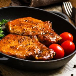 Pork chops marinated in rum and mustard